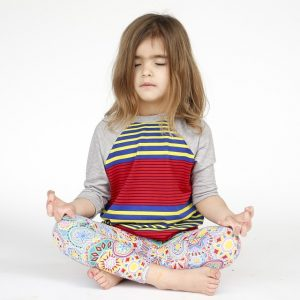 child doing a yoga pose
