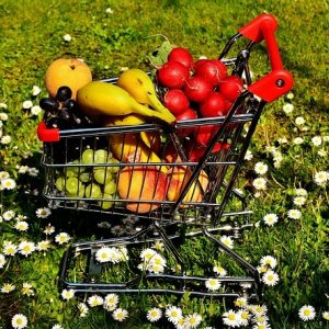 a small shopping cart full of delicious fruits and vegetables