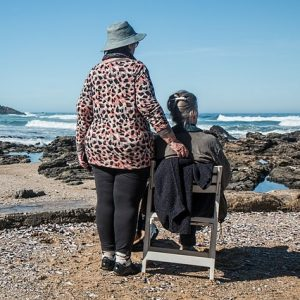 two elderly women on a beach