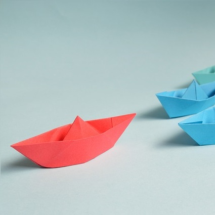 image of paper boats in different colors