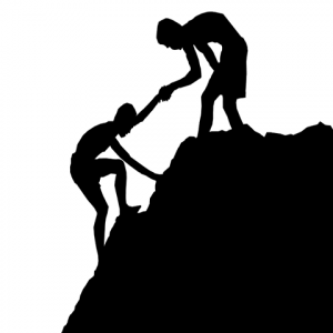 image of one person helping another up a hill