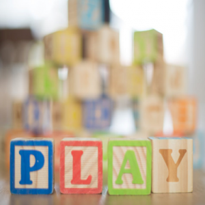 image of children's blocks spelling the word play