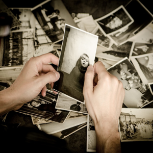 image of old photos and person's hands