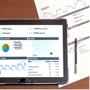 image of ipad and statistics sheet