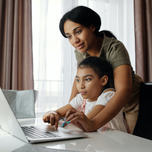 mother and daughter in front of laptop