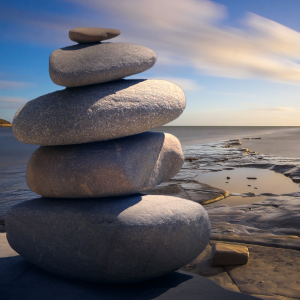 stacked rocks by water